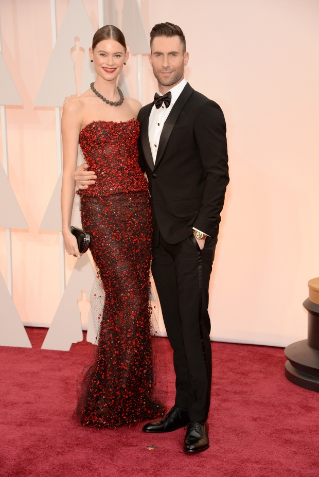 Behati Prinsloo, in Armani Privé, and Adam Levine, in Giorgio Armani
