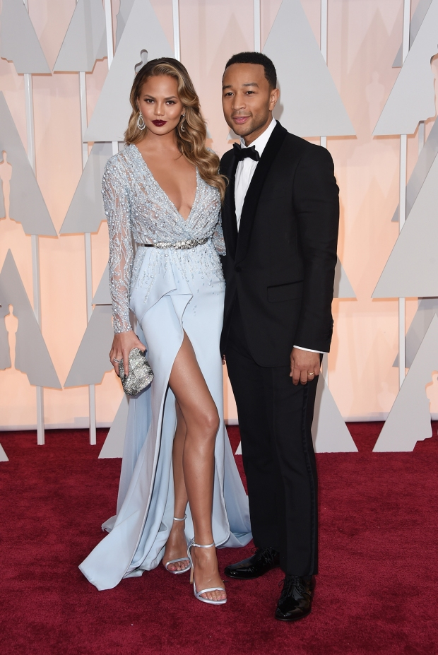 Chrissy Teigen, in Zuhair Murad Haute Couture, and John Legend, in Gucci